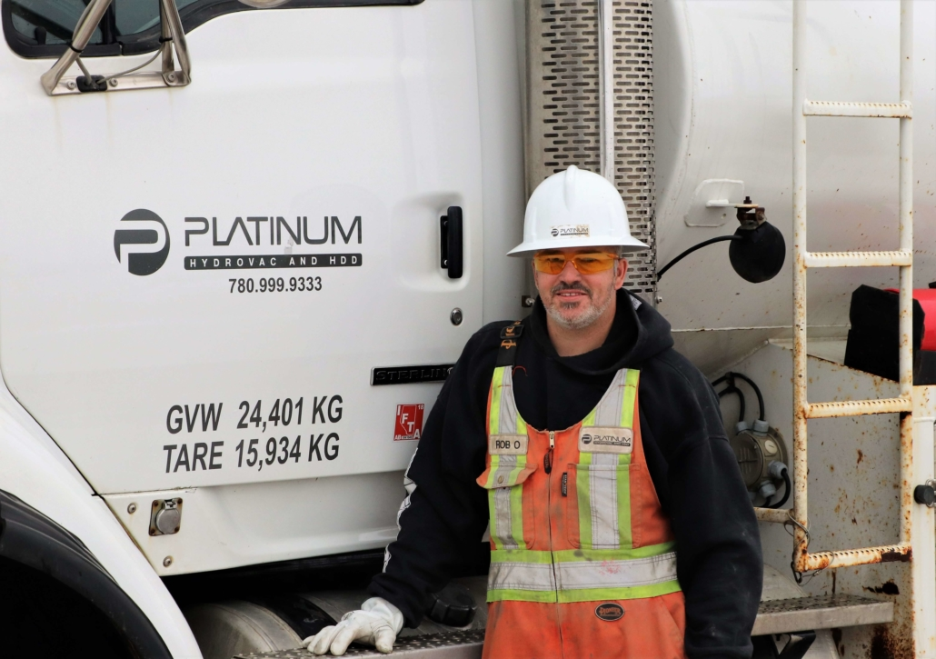 Platinum Employee Rob O standing in front of a platinum truck smiling