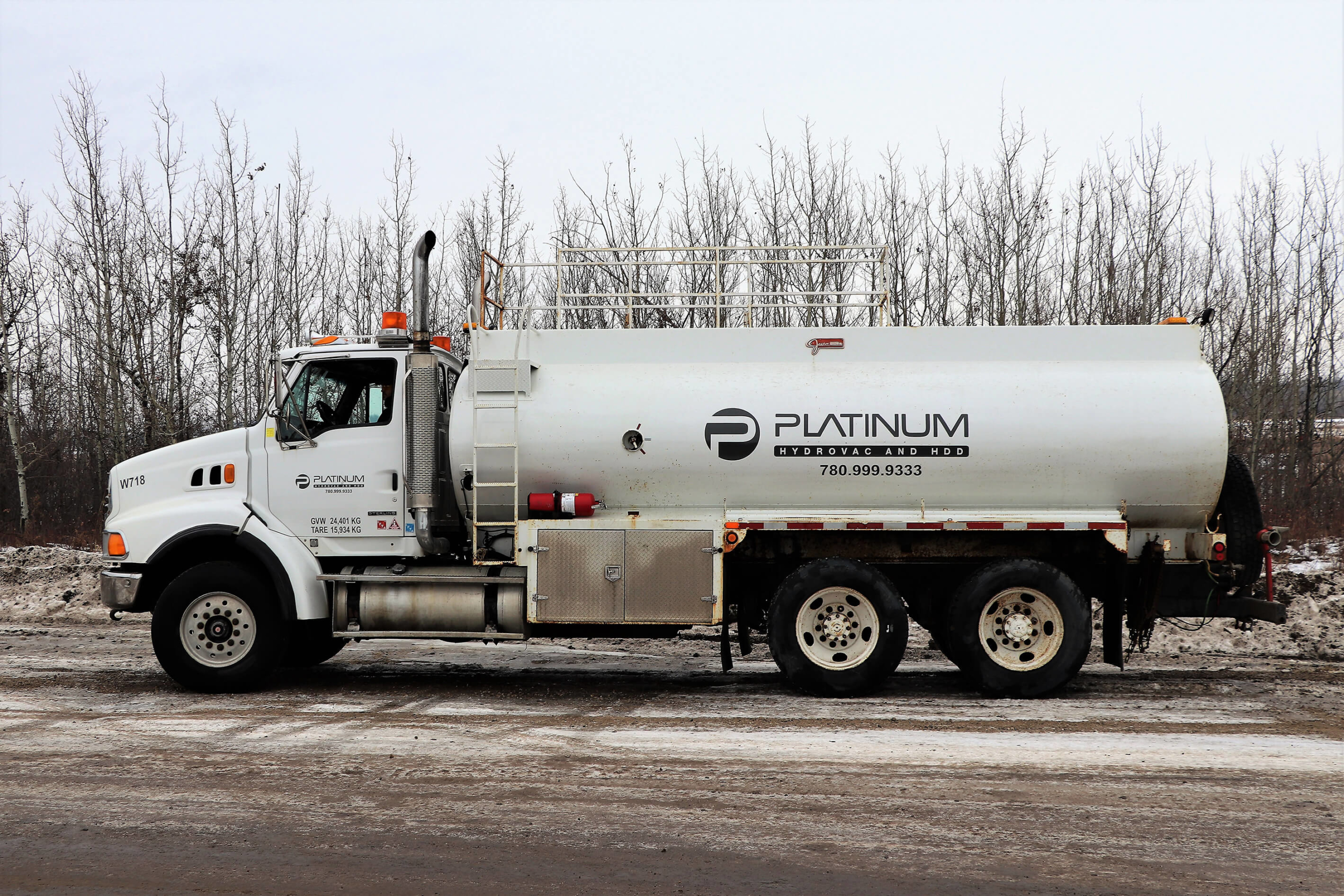 A white platinum water truck parked on the road